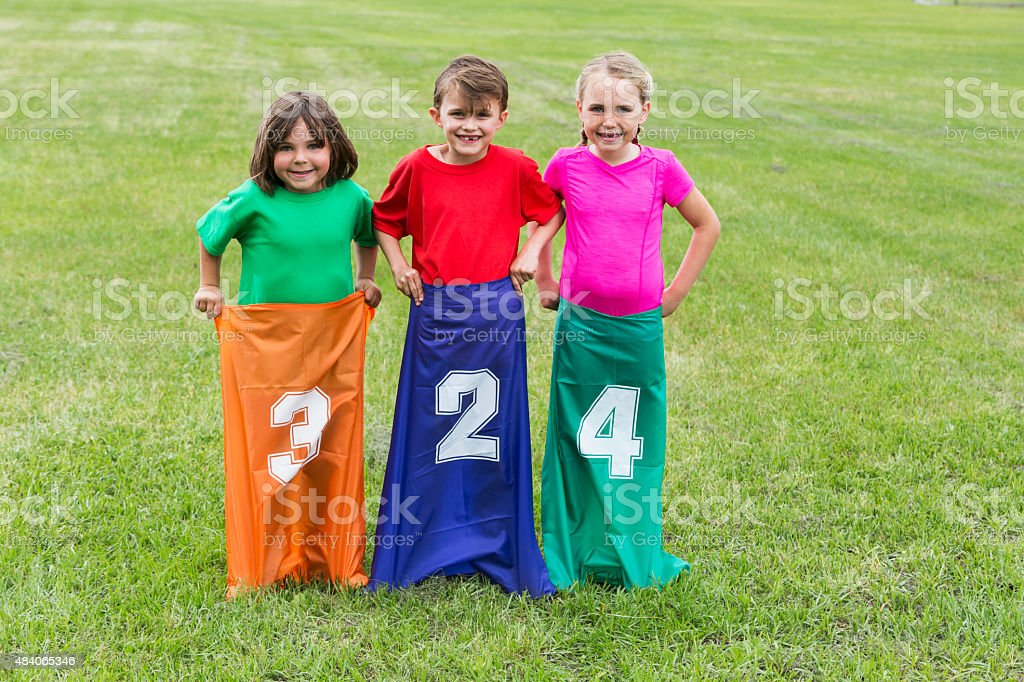 Children in park ready for a potato sack race stock photo