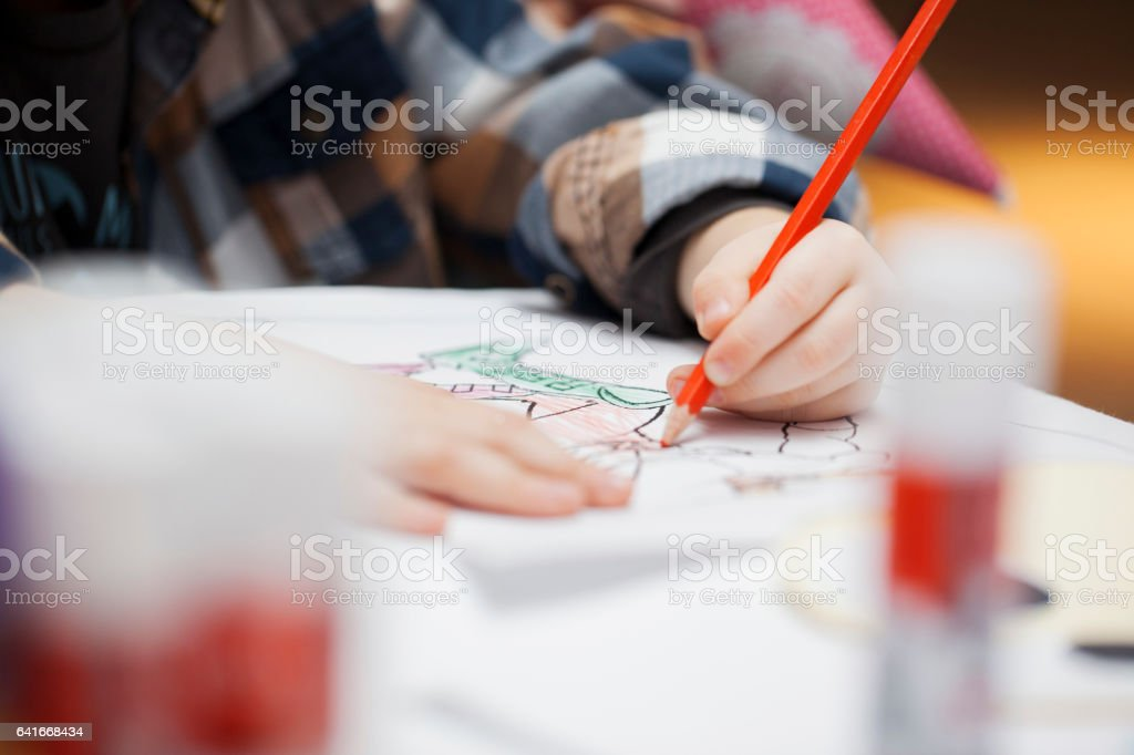 Children in pre-school workhsop - close up stock photo
