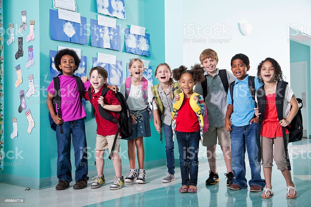 Children in school hallway stock photo