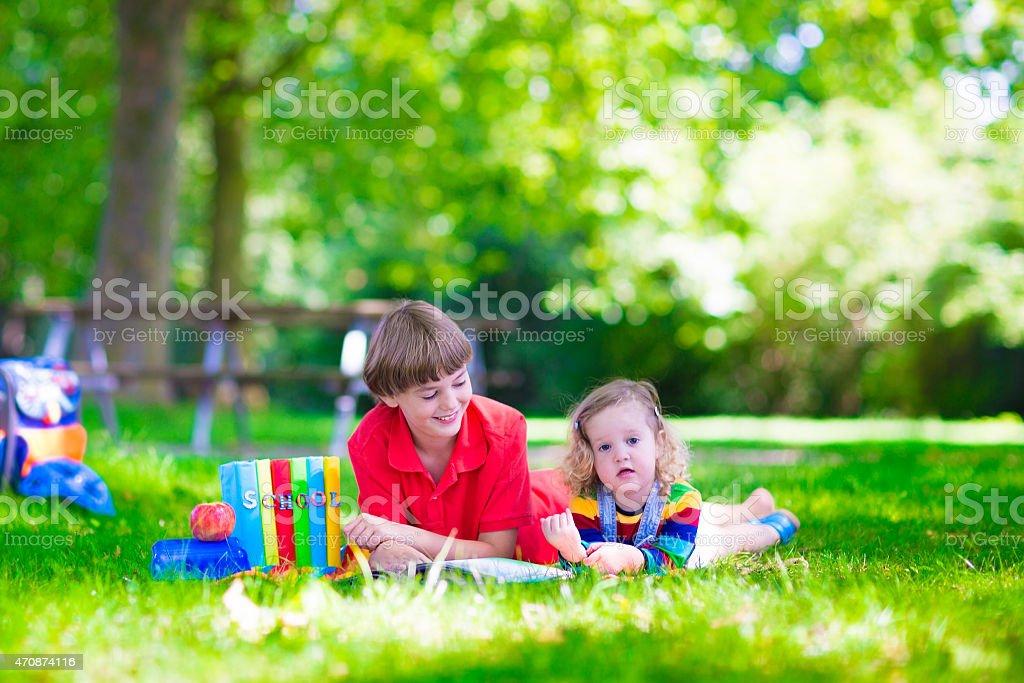 Children in school yard stock photo