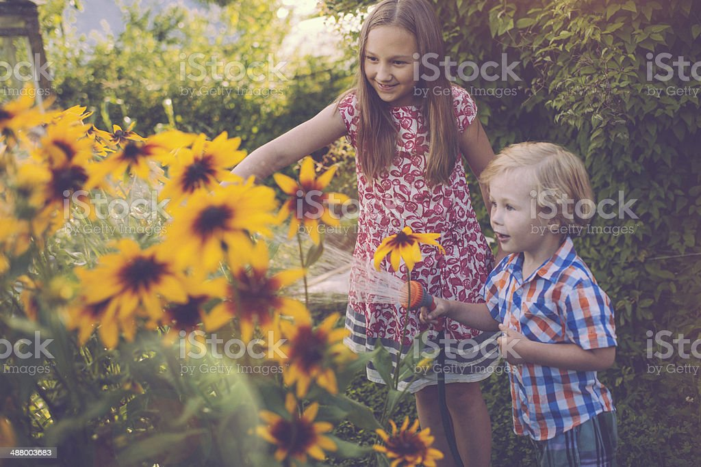 Children in the garden royalty-free stock photo