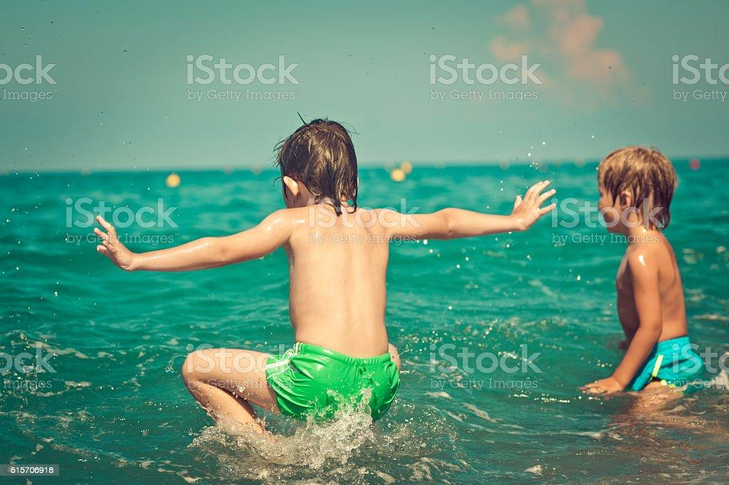 Children in the sea stock photo