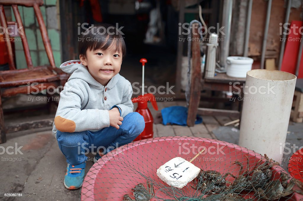 Children in the vegetable market stock photo