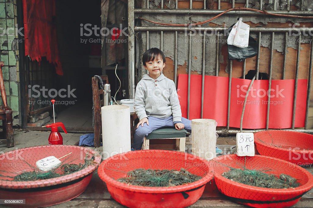 Children in the vegetable market stock photo