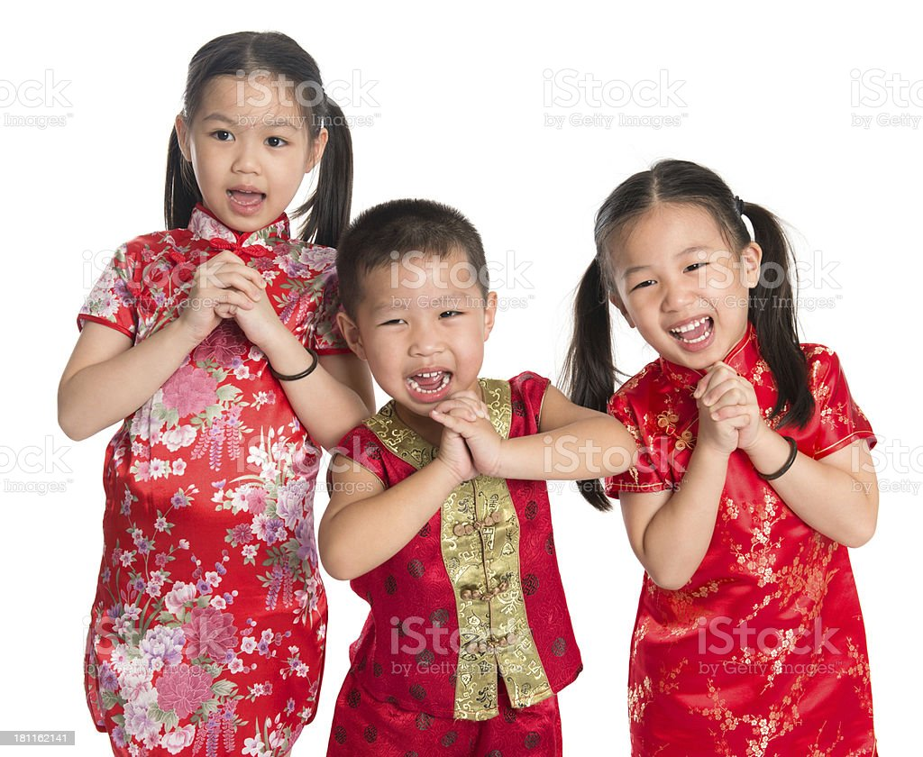 Children in traditional dress during Chinese New Year stock photo