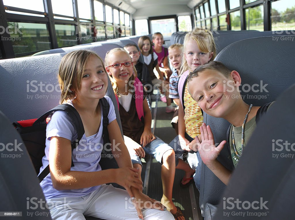 Children inside school bus stock photo
