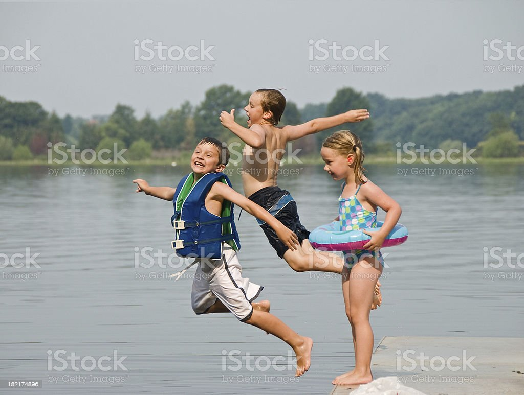 Children Jumping into the Lake stock photo