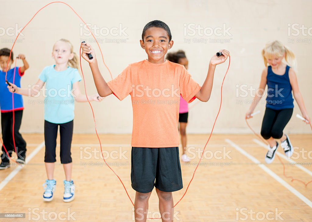 Children Jumping Rope at School stock photo
