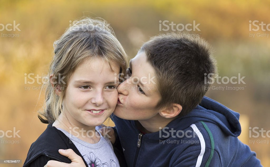 Children kiss stock photo
