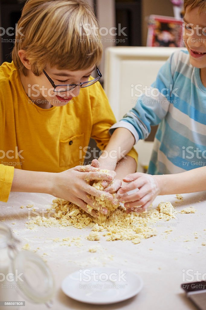 Children kneading dough stock photo