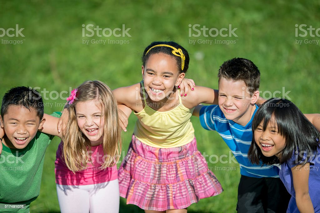 Children Laughing Together at the Park stock photo
