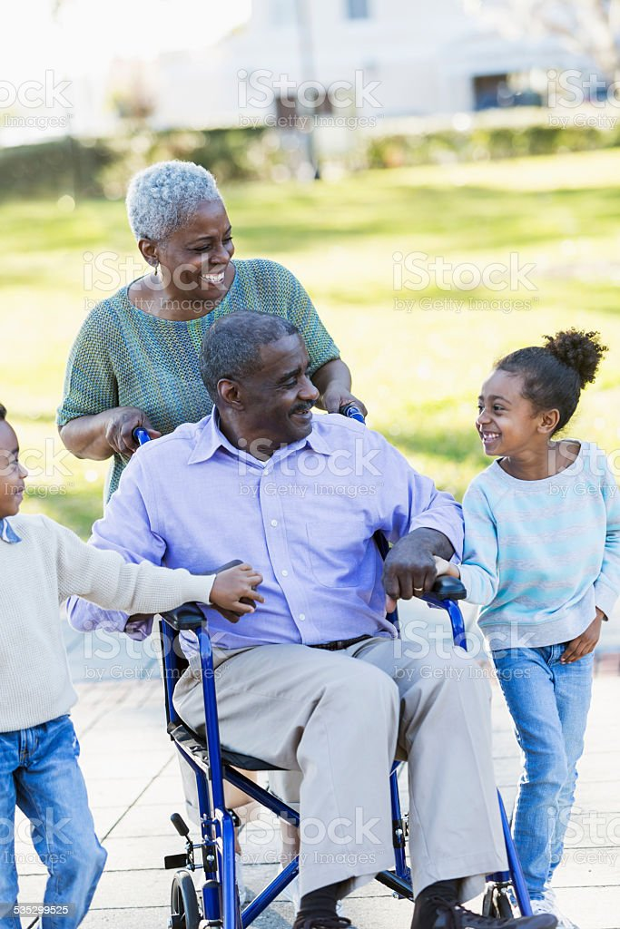 Children laughing with their grandparents stock photo