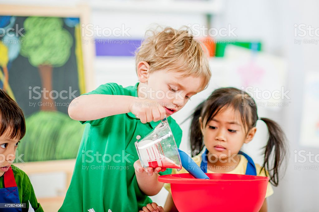 Children Learning a New Skill stock photo