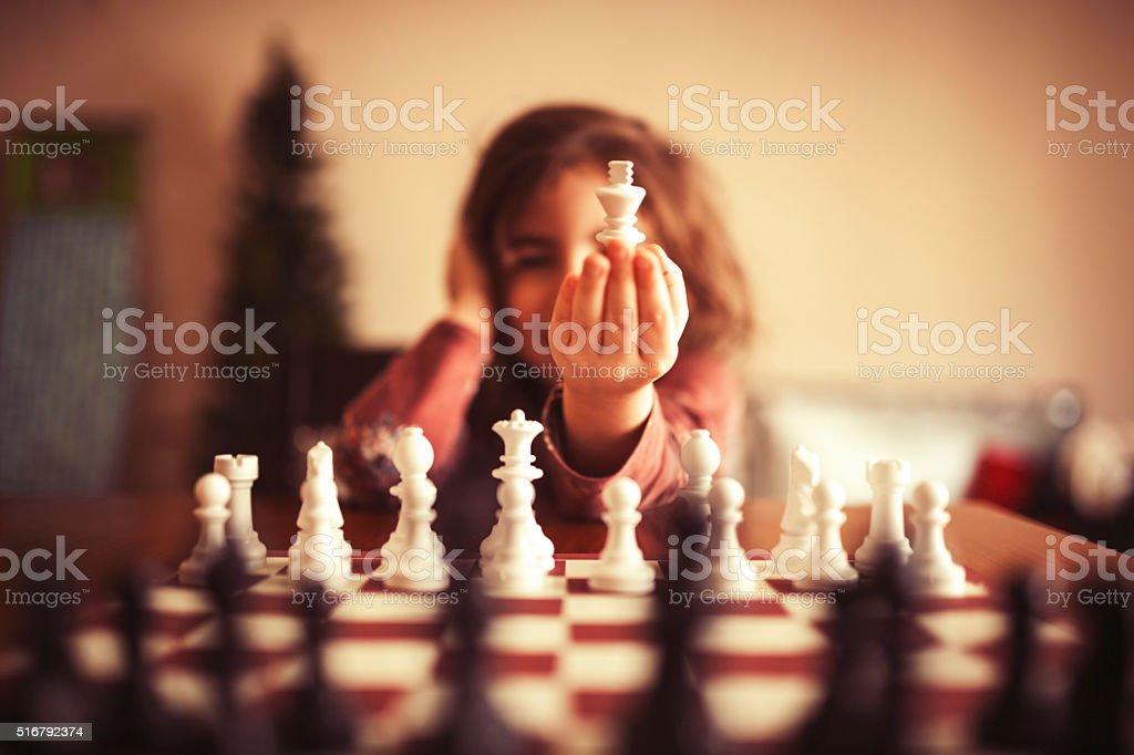 Children learning chess stock photo
