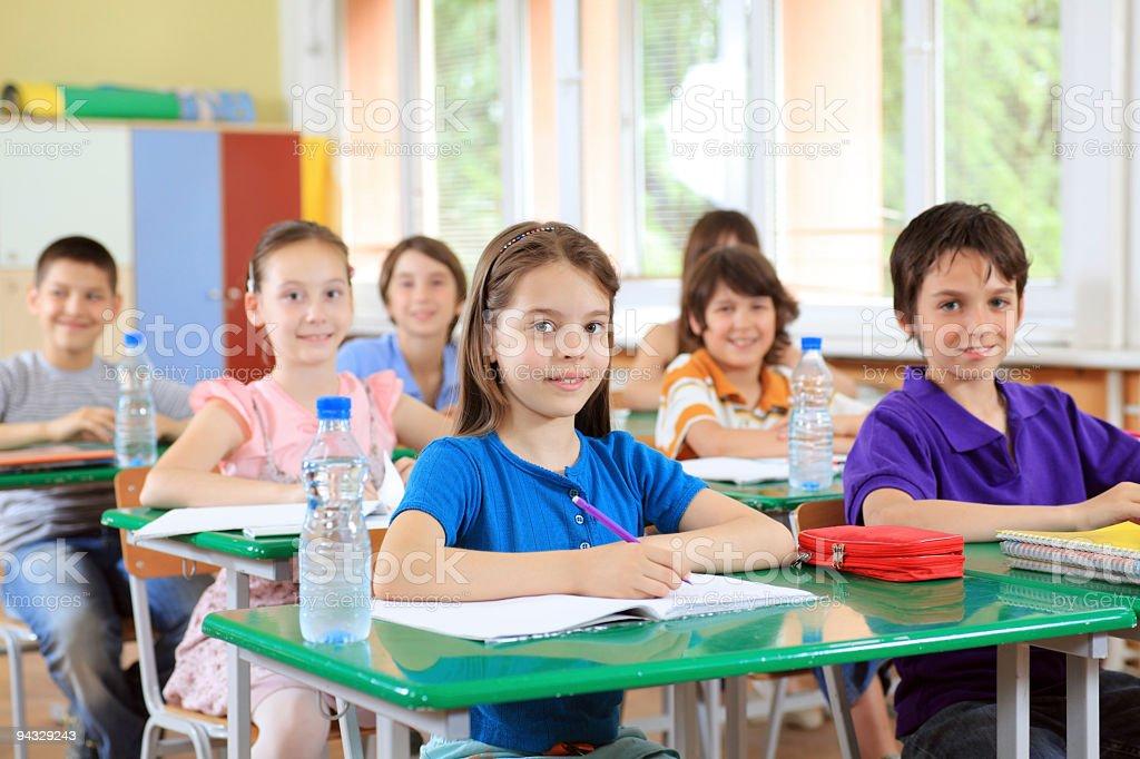 Children learning in school. stock photo