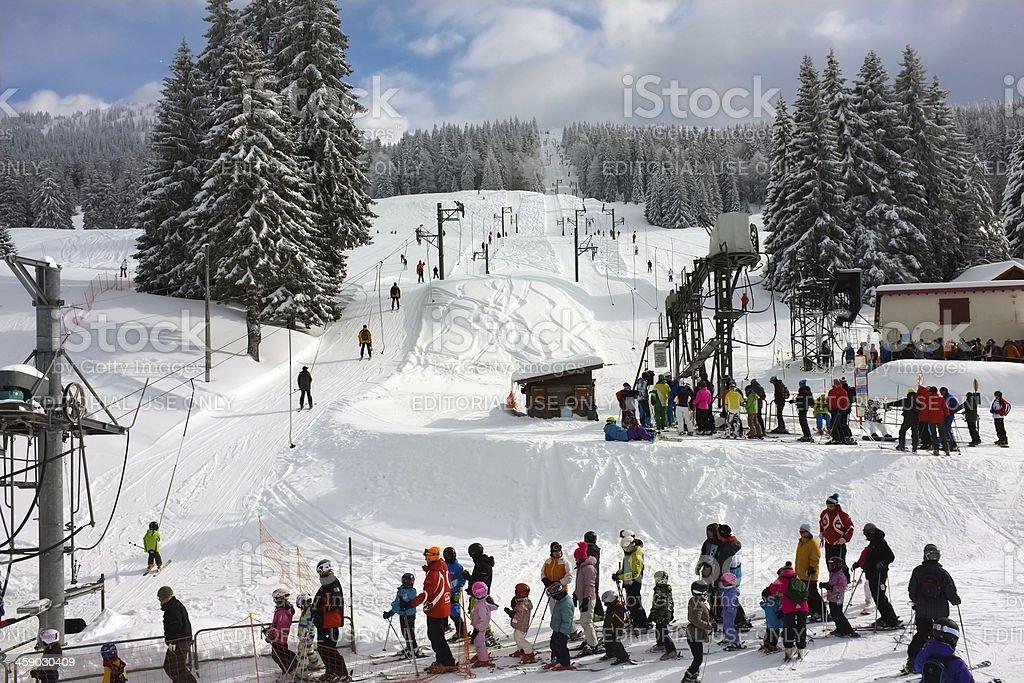 Children learning ski in La Dole stock photo