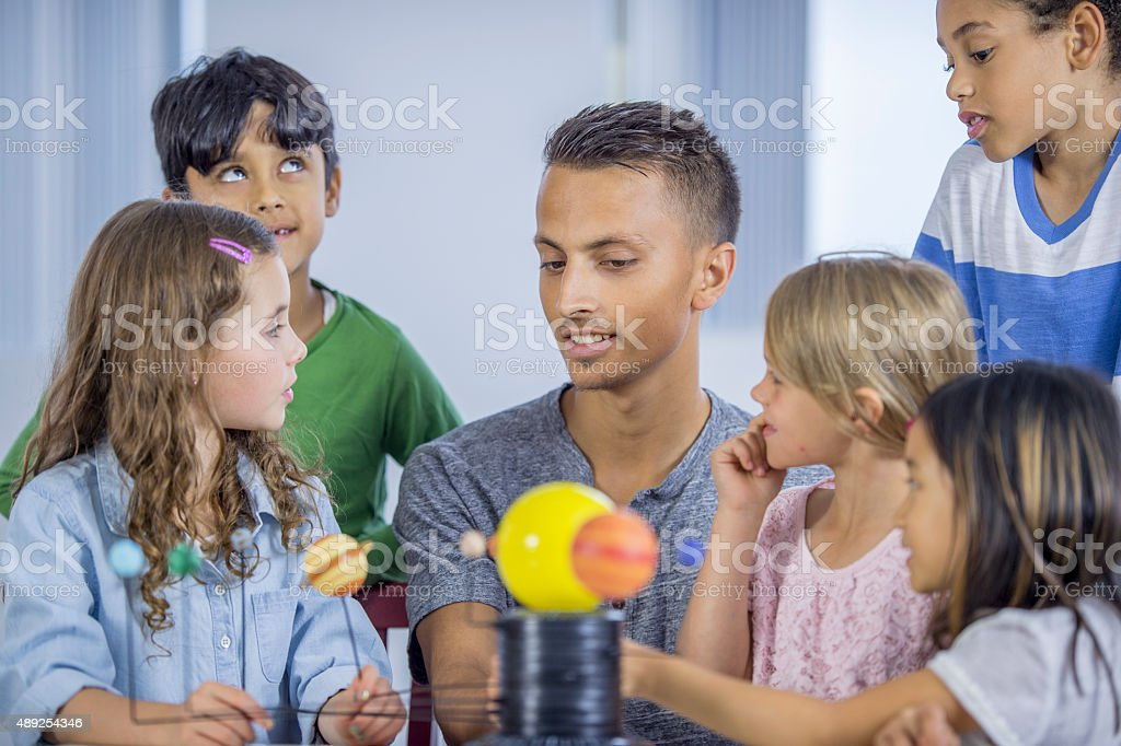 Children Learning the Solar System stock photo