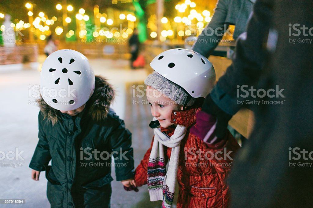 Children learning to Ice-skate stock photo