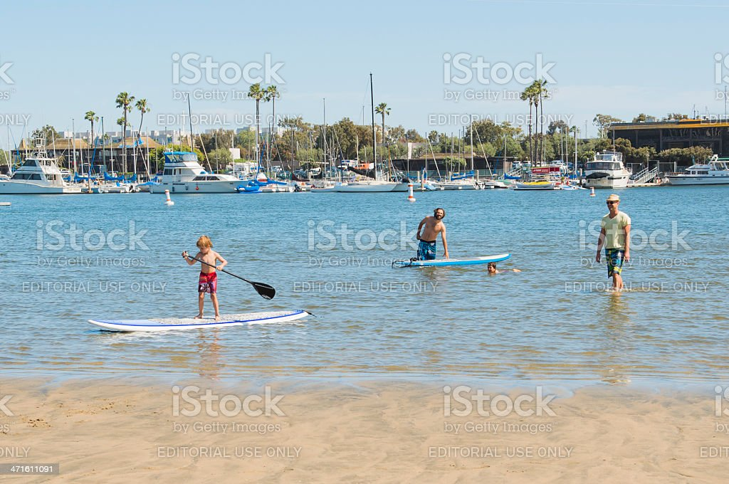Children Learning to Paddleboard royalty-free stock photo