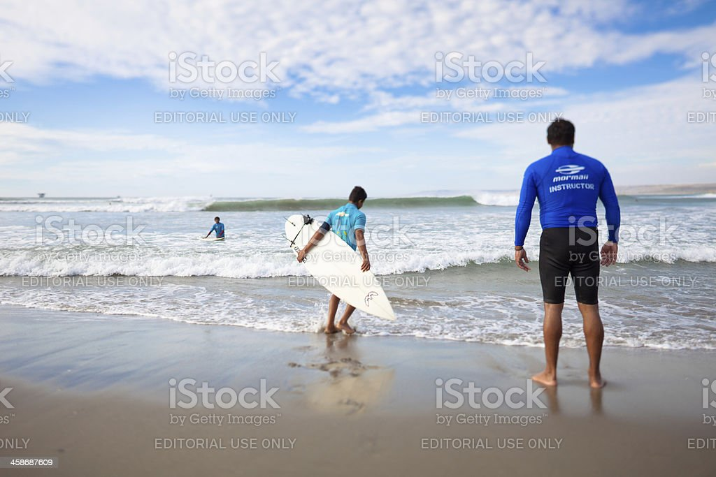 Children learning to surf in Peru stock photo