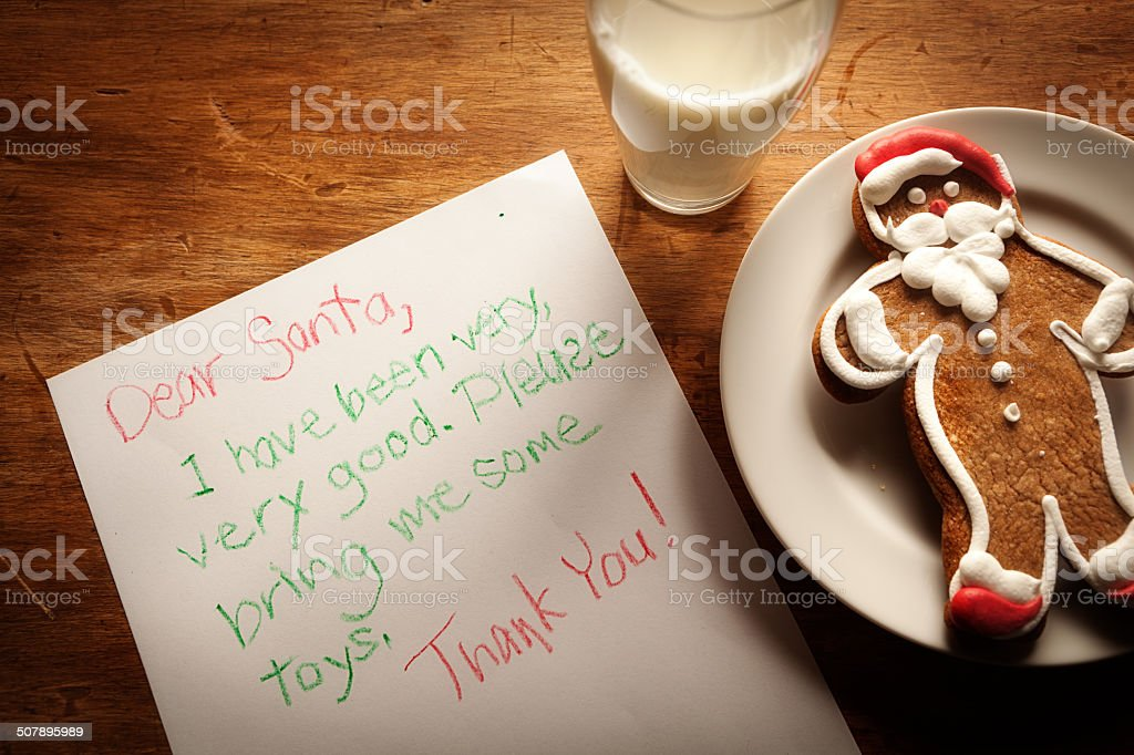 Children Letter to Santa Claus with Cookie and Milk stock photo