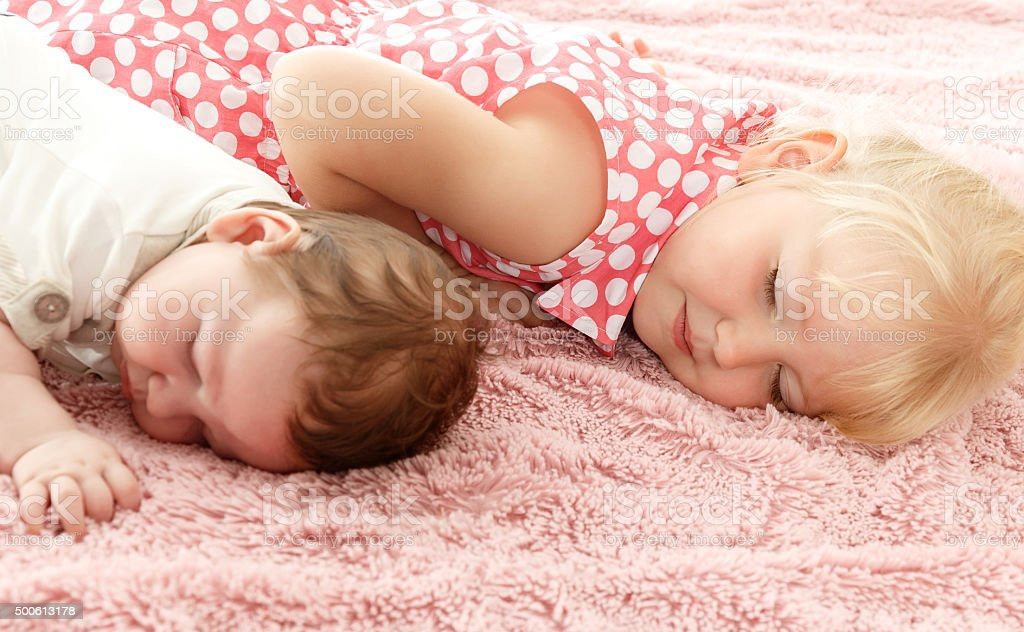 Children lie on the mat stock photo