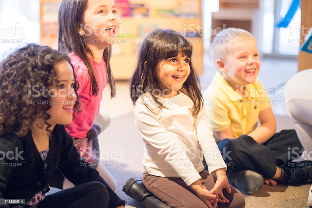 Children Listening to a Story stock photo