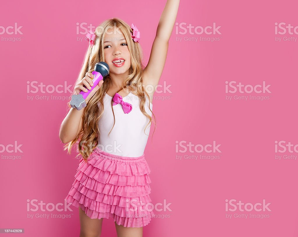 children little star singer like fashion doll with mic stock photo