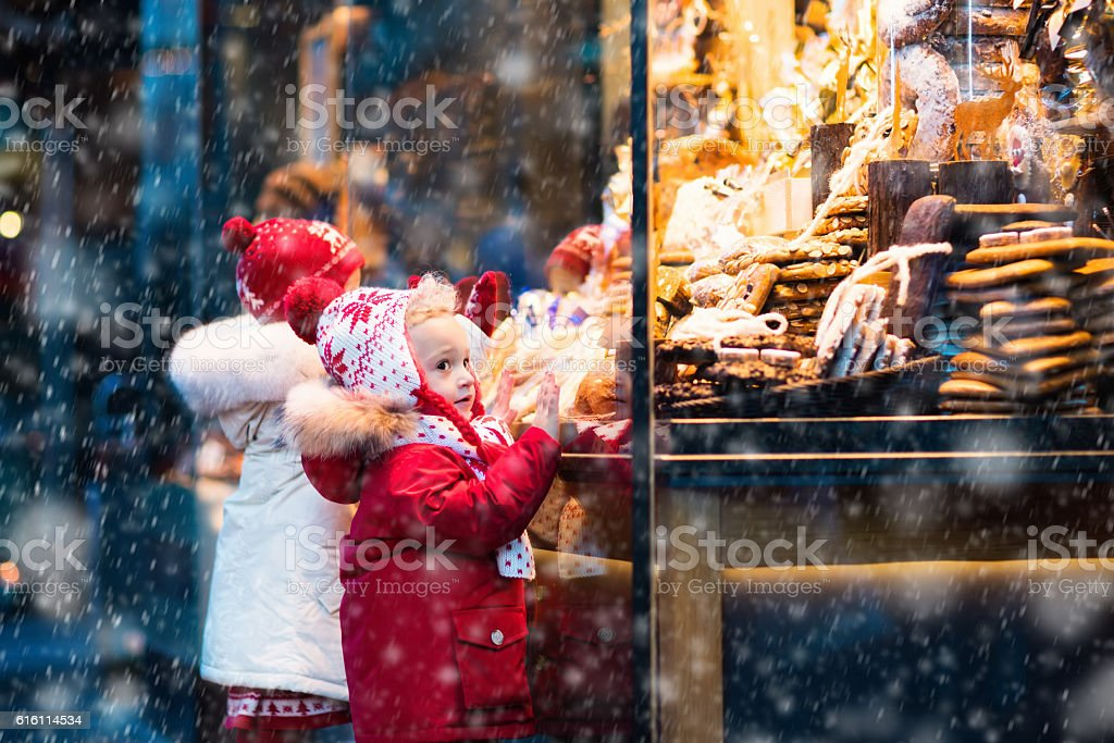 Children looking at candy and pastry on Christmas market stock photo