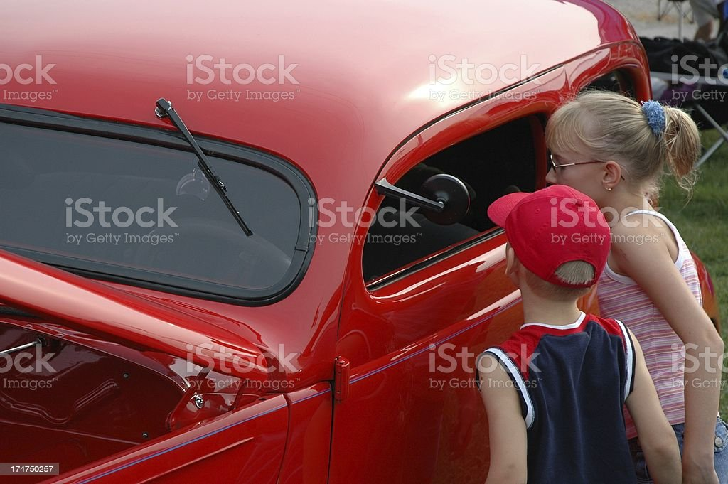 Children Looking at Grandpa's Classic Hot Rod During Car Show royalty-free stock photo