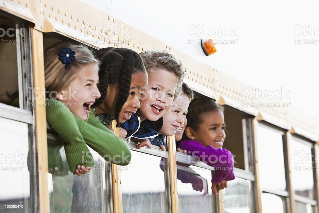 Children looking out school bus window stock photo