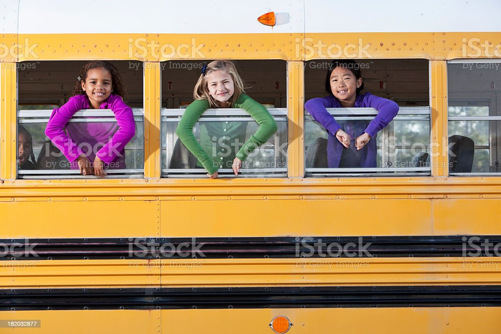 Children looking out school bus window royalty-free stock photo