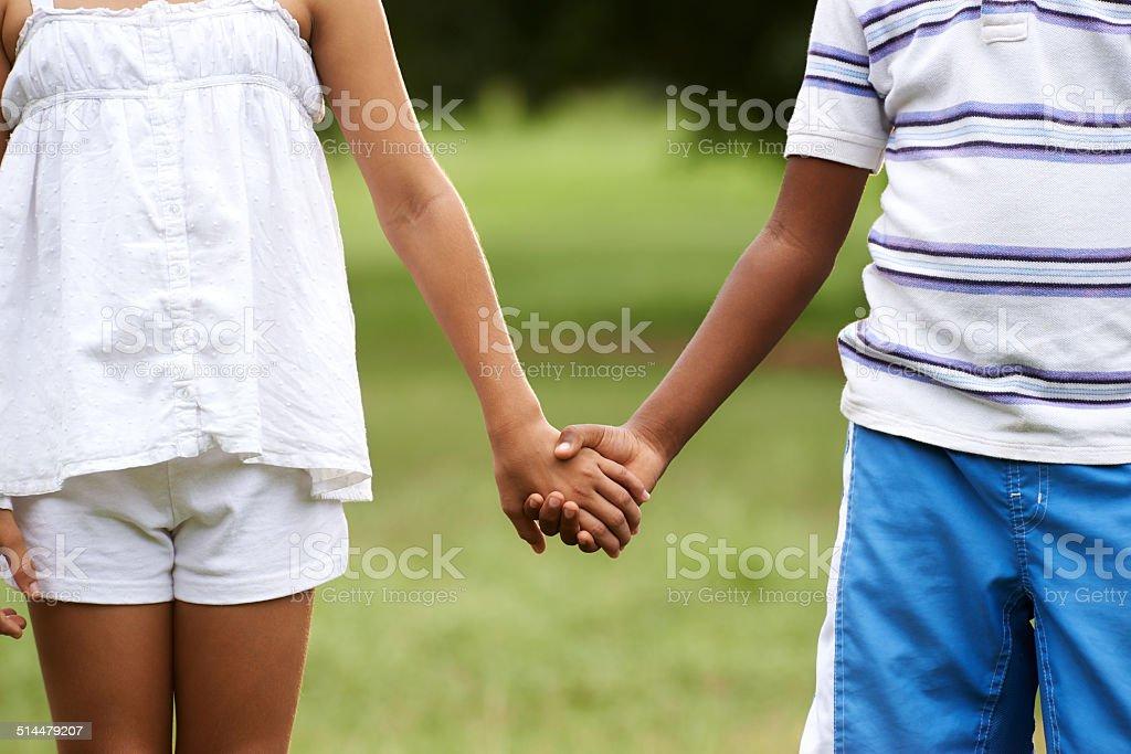 Children love black boy white girl holding hands stock photo