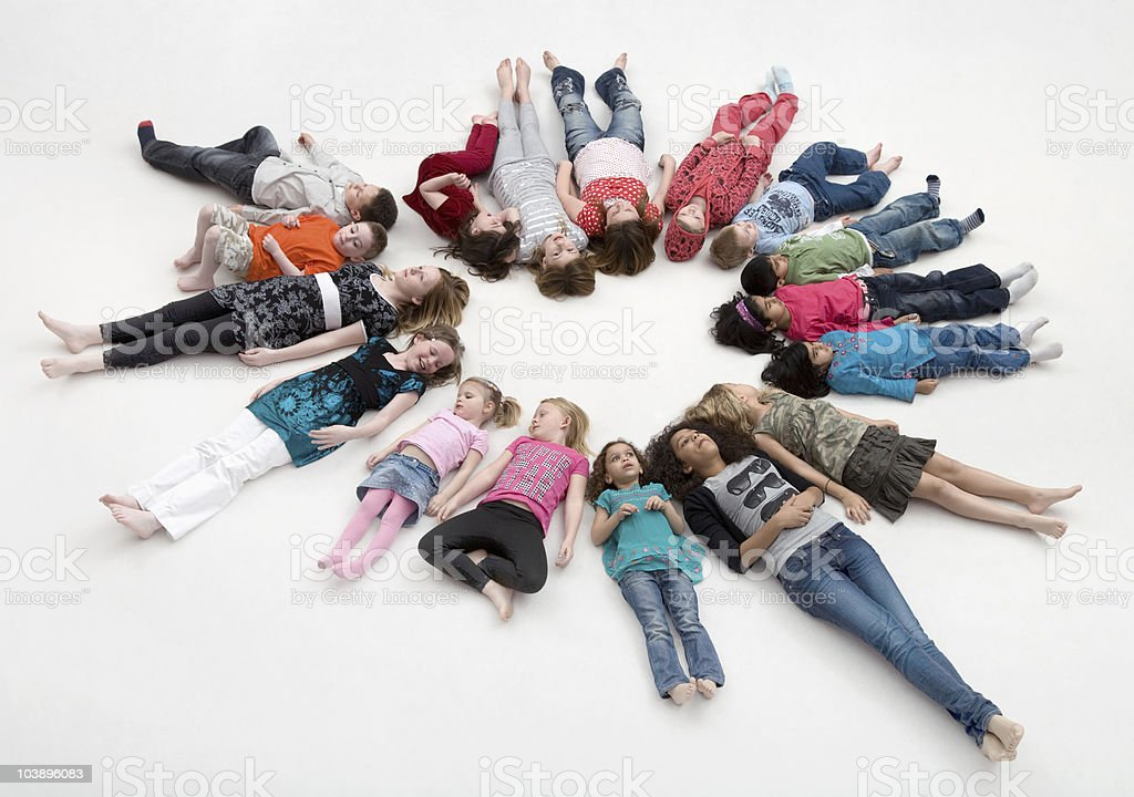 Children lying in a circle. royalty-free stock photo
