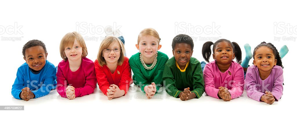 Children Lying in a Row stock photo
