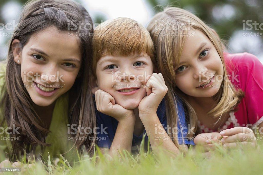 Children Lying On Grass royalty-free stock photo