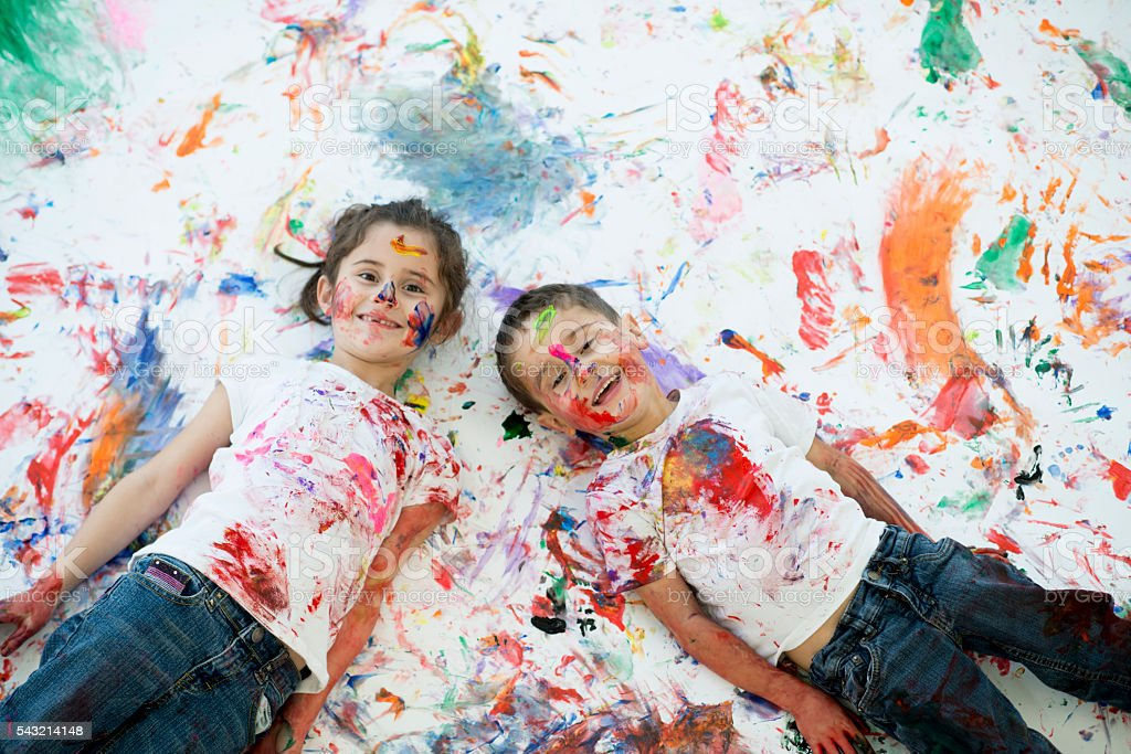 Children Lying on Their Creative Painting stock photo