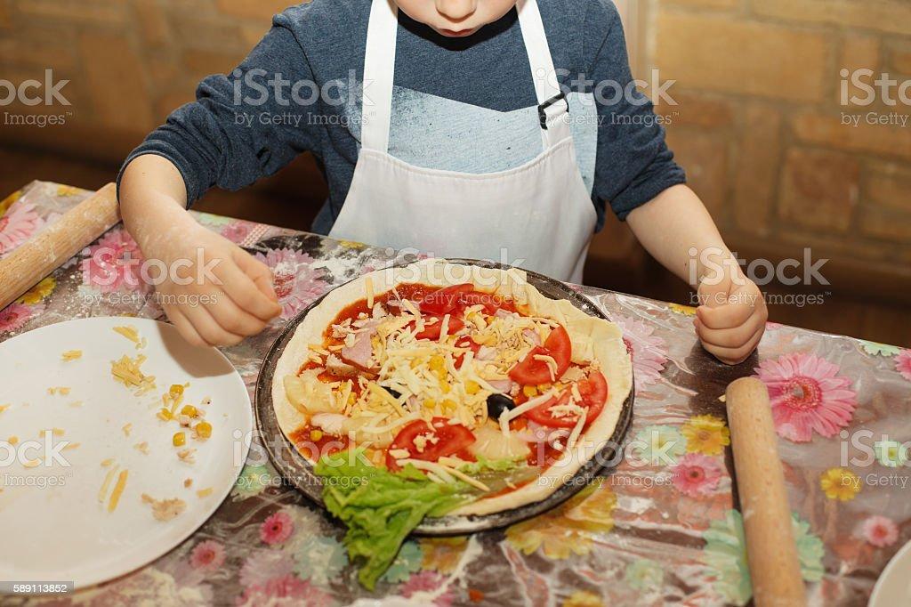 Children make pizza. Master class for children on cooking Italia stock photo