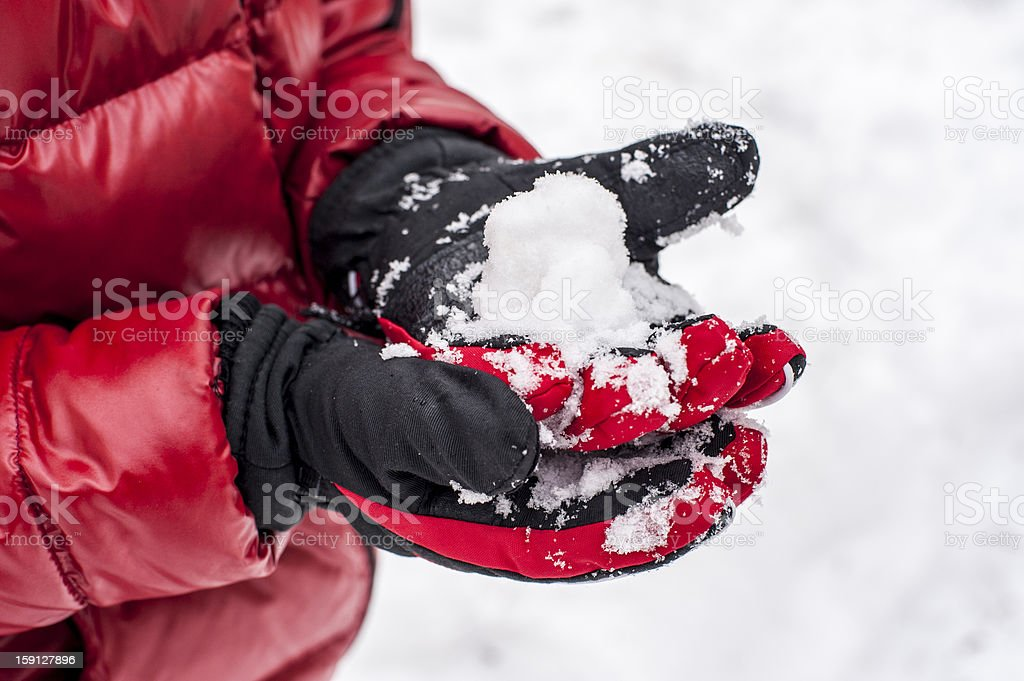 Children making a snow balls royalty-free stock photo