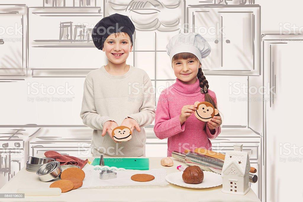 Children making christmas cookies stock photo