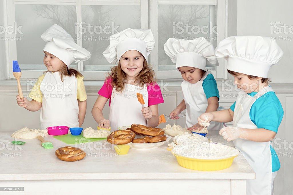 Children Making Dough For Baking stock photo