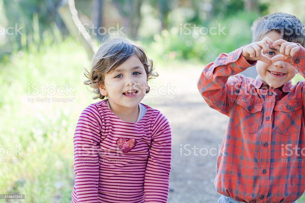 Children making Heart Shape with Hands stock photo
