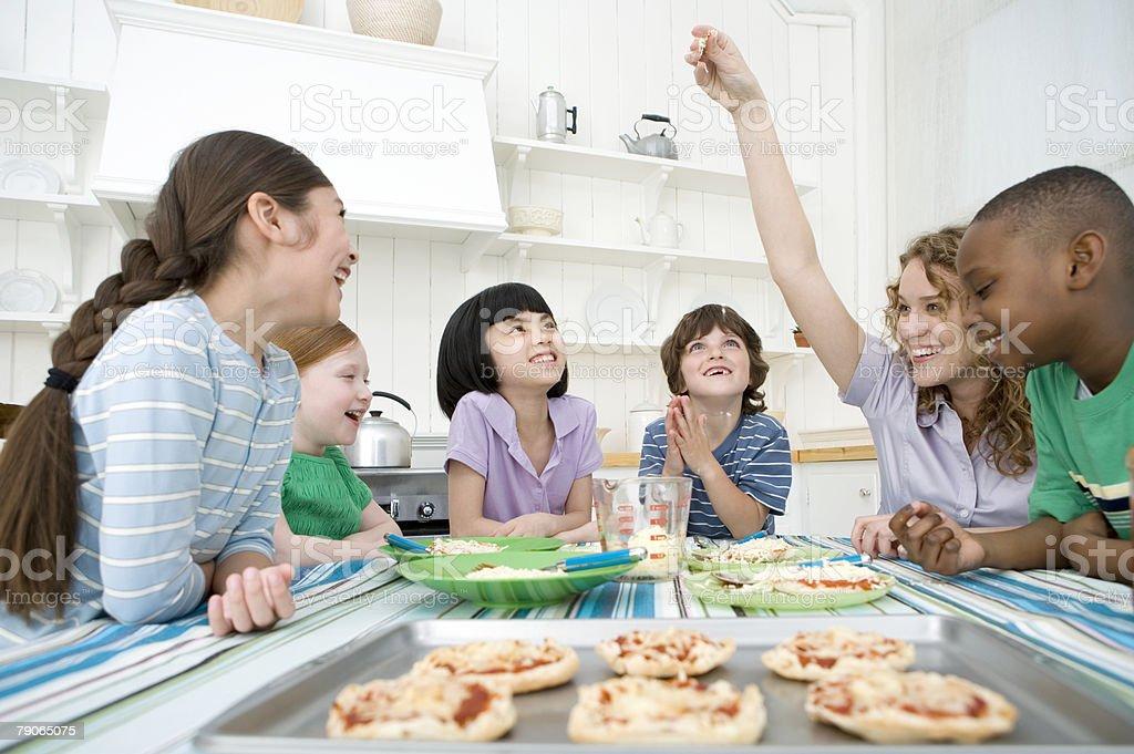 Children making pizzas royalty-free stock photo