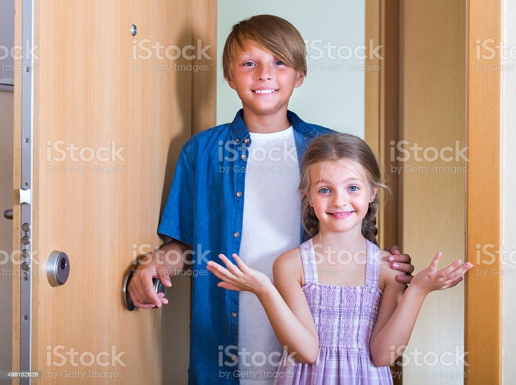 Children near opened door stock photo