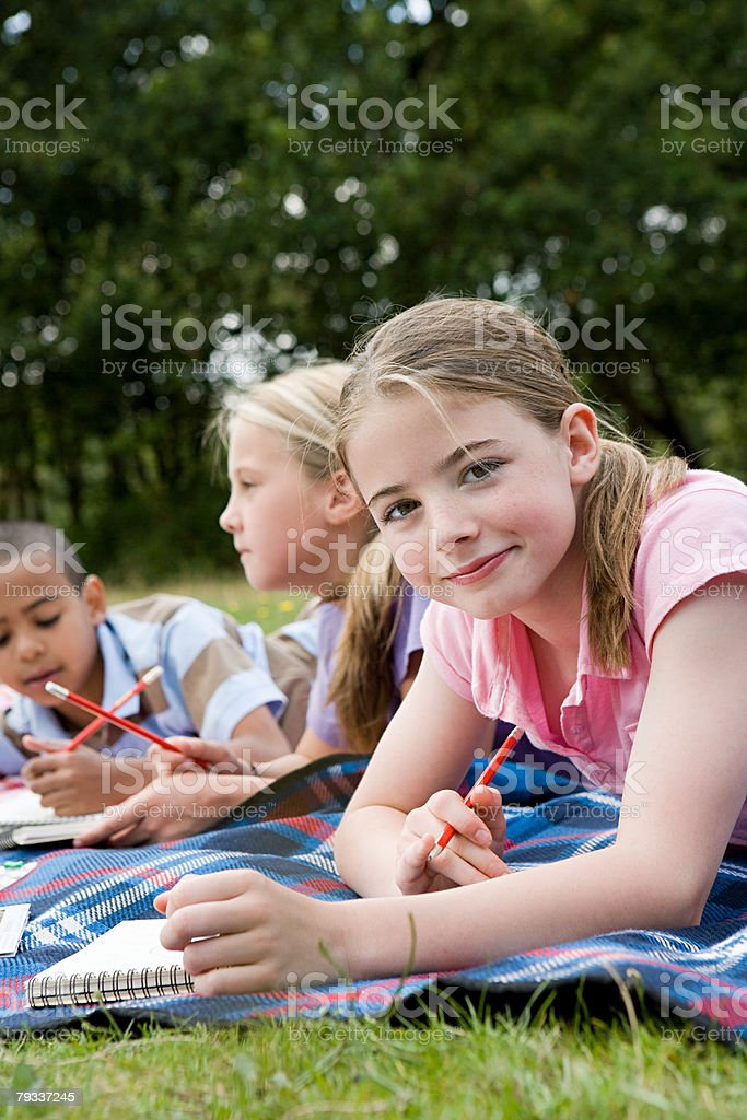 Children on a blanket stock photo