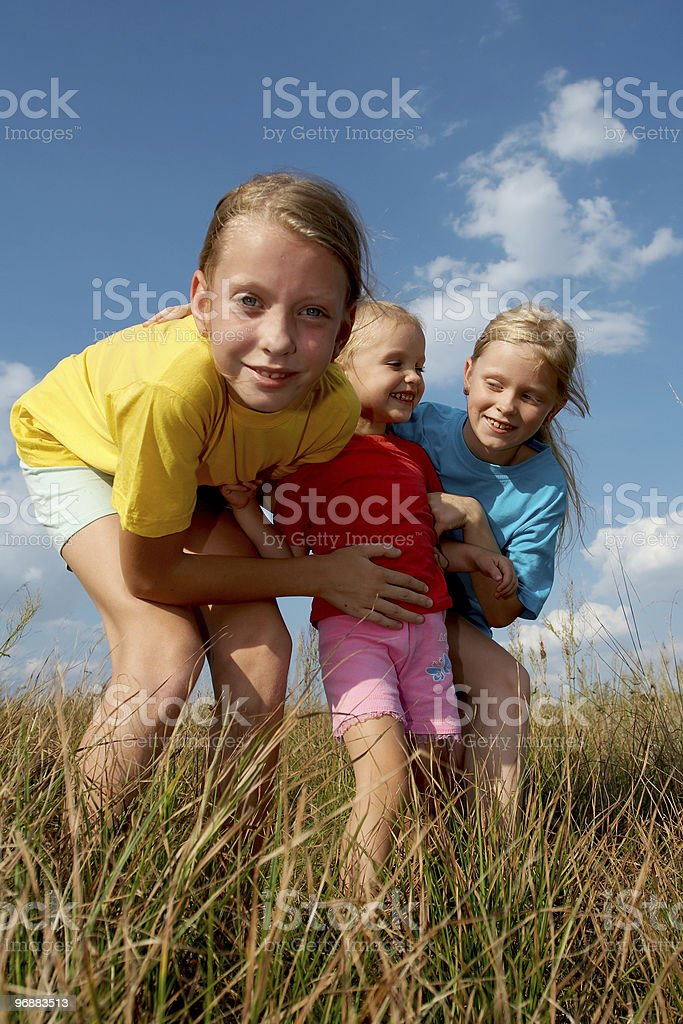 Children on a meadow stock photo