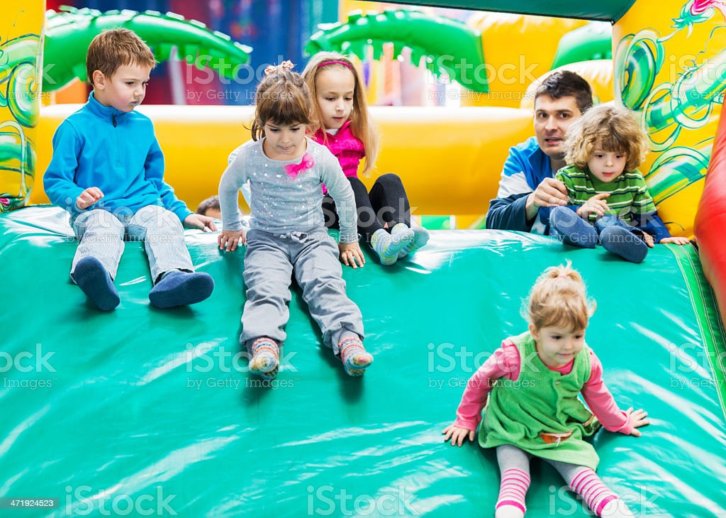 Children on an inflatable slide. royalty-free stock photo