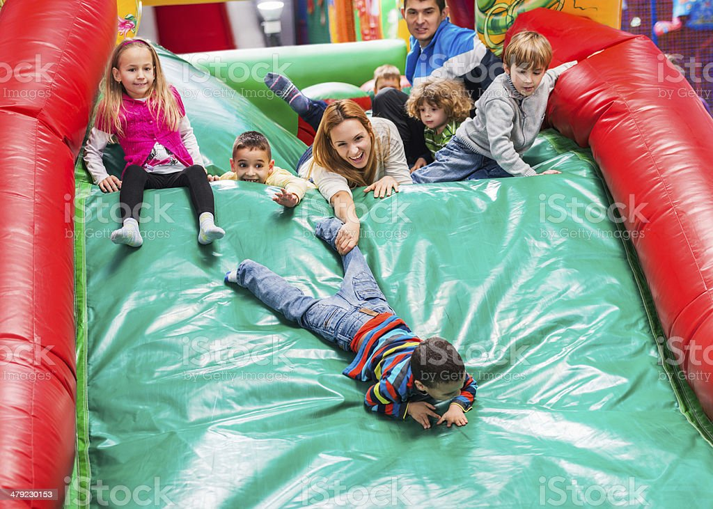 Children on an inflatable slide. stock photo