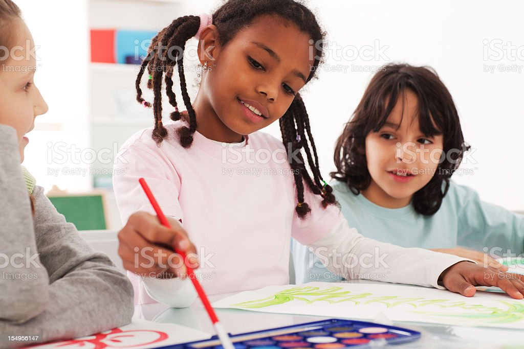Children on arts class drawing with a watercolors. royalty-free stock photo