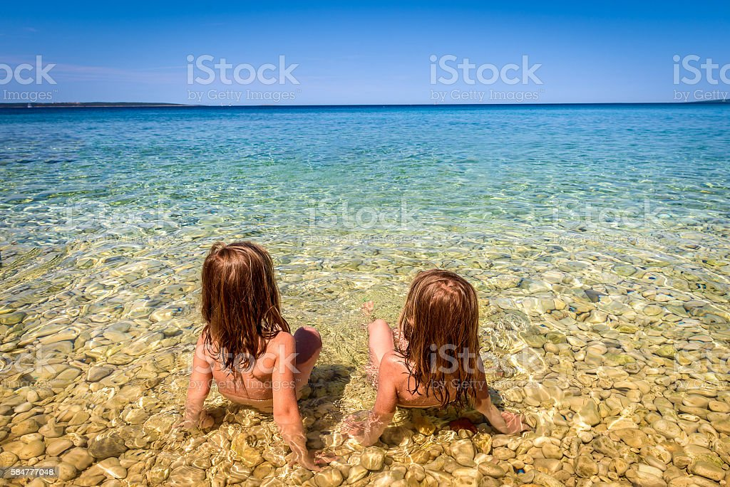 Children on Beach in Croatia island Pag or Hvar. stock photo